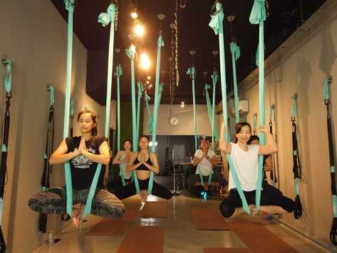 Aerial yoga pose in fitness studio in singapore
