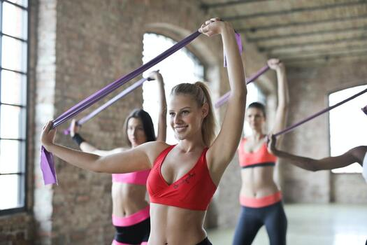 Group fitness class with female smiling in singapore